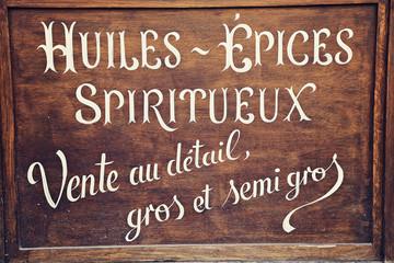 enseigne vintage huiles épices spiritueux