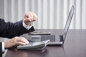 Business man's hands using the laptop