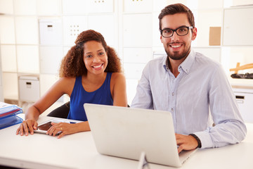 Businesspeople Using Laptop In Office Of Start Up Business