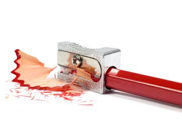 Macro Shot of Metallic Pencil Sharpener Sharpening Red Pencil
