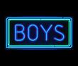 Boys neon sign illuminated over dark background