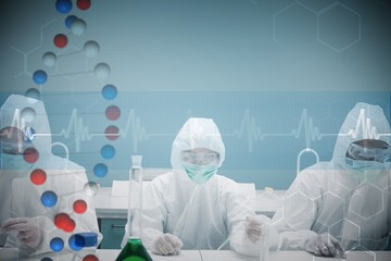 Composite image of chemists working in protective suits