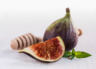 ripe figs with a wooden spoon