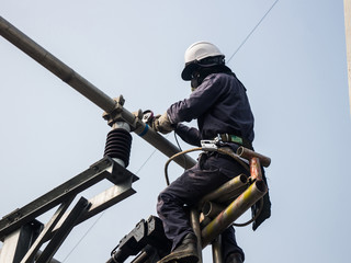 Workers setting up an electric sub station