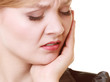 Toothache. Young woman suffering from tooth pain isolated