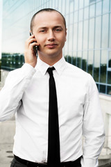 portrait of young man talking phone