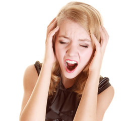 Businesswoman with headache head pain screaming
