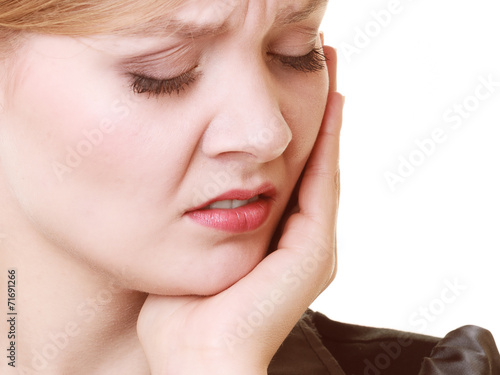 canvas print picture Toothache. Young woman suffering from tooth pain isolated