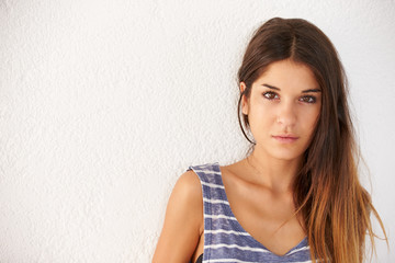 Portrait Of Casually Dressed Woman Leaning Against Wall