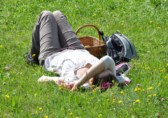 view of woman relaxes on the meadow
