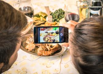 Couple of boyfriend and girlfriend taking a food selfie in dinne