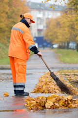 Street sweeper cleaning city pavement from dead leaves