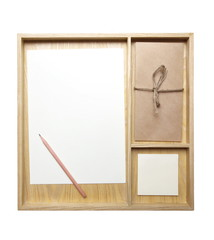 White blank note paper in a natural wood tray
