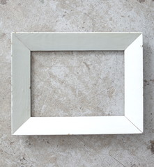 white wood picture frame on concrete floor