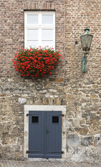 door entrance of house with flowers