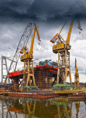 Big industrial crane on a dramatic sky background.