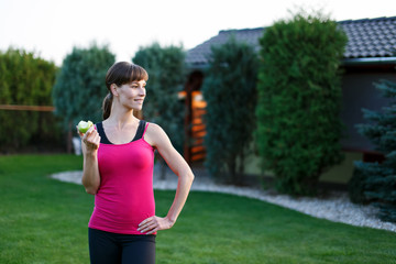 Woman eating apple outdoor