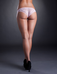 Image of leggy model with elastic ass, close-up