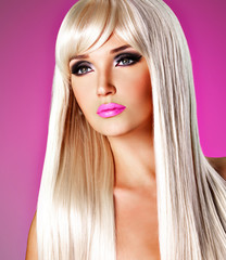 Portrait of  a  beautiful  woman with long white straight  hairs