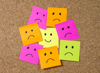 smiley post it note in happiness versus depression concept