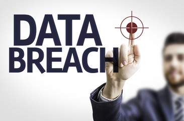 Business man pointing the text: Data Breach
