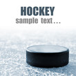black hockey puck on ice rink