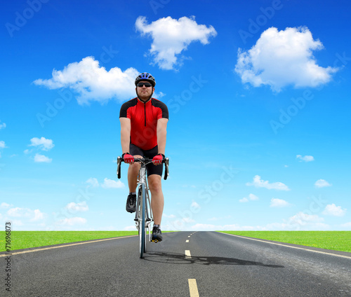 canvas print picture Cyclist riding on a road bike