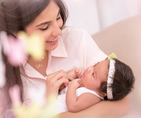 Happy mother with little daughter