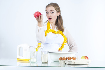 Smiling homemaker with apples