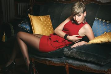 Sensual woman on a velvet sofa