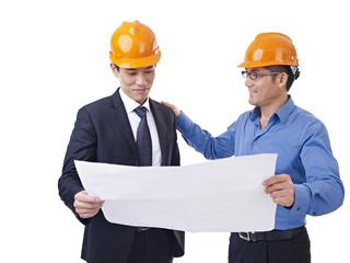 asian businessman patting coworker on the shoulder