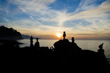 Rock silhouette on the sea