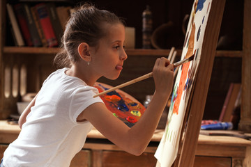 Young talented  girl artist painter