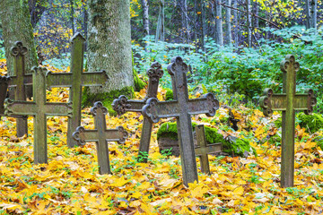 Old iron crosses an abandoned cemetery