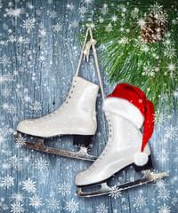 Pair of White Ice Skates and Santa Claus hat - backround