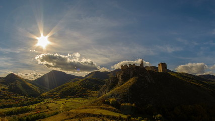 fortress in autumn landscape time lapse with sun Transilvania