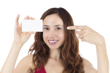 Smiling woman pointing to a blank business card