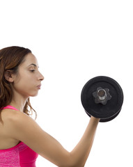 Concentrated fitness woman working out her biceps