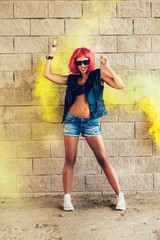 Young sexy girl in red wig having fun