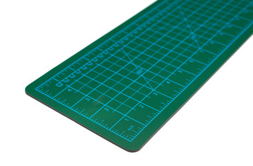 green cutting mat on a white background