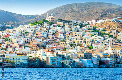 Greek island with colorful houses and yachts. - 71699609