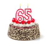 Geburtstagstorte mit brennender Kerze Nummer 65