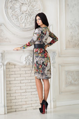 Woman in midi dress in studio