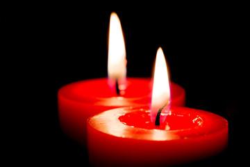 Closeup of burning candles on black background, christmas, holid