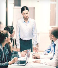strict female boss talking to business team