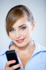Pretty Smiling Woman Using Black Mobile Phone
