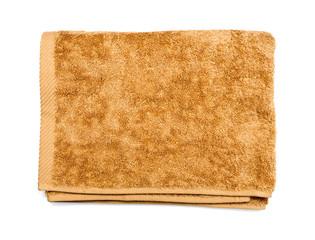 Light brown folded towel on white
