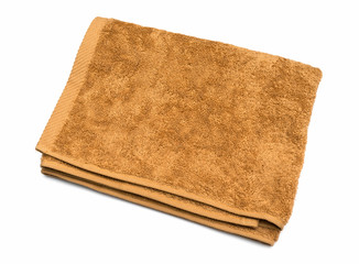 Light brown folded towel on white