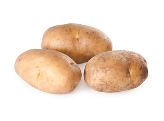 Raw organic potatoes on a white background.