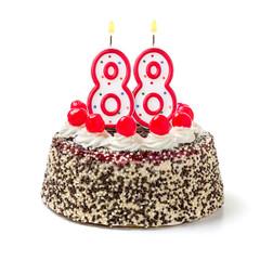 Geburtstagstorte mit brennender Kerze Nummer 88